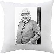 Pillow with Man standing and smiling.